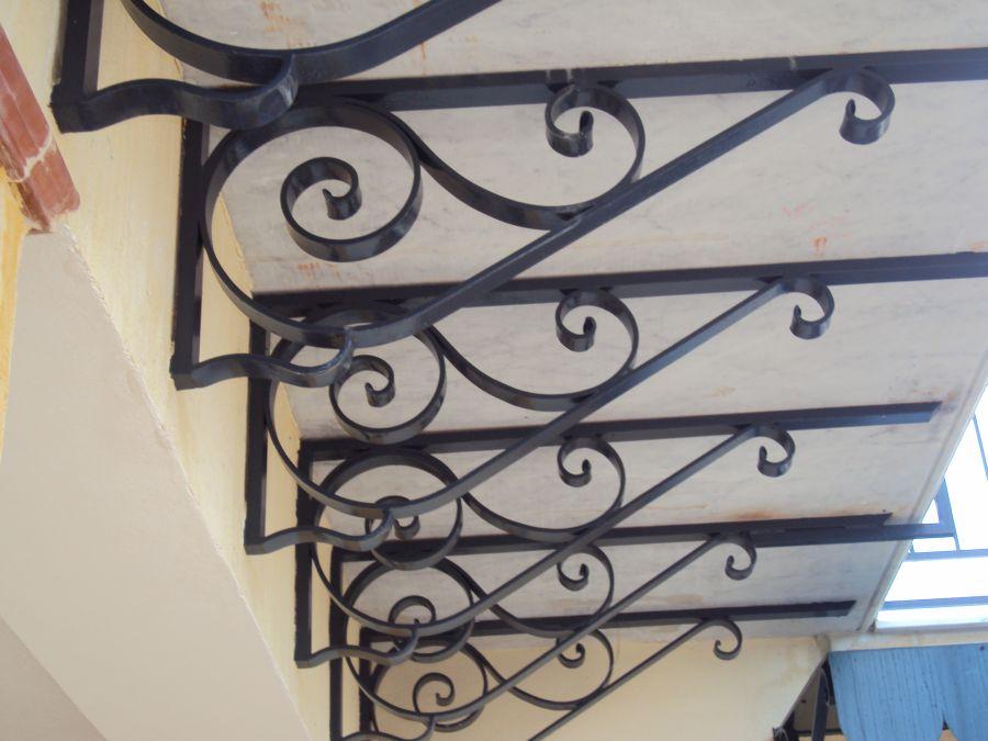 Arte ferro di giannone lavorazione ferro battuto for Mensole in ferro battuto